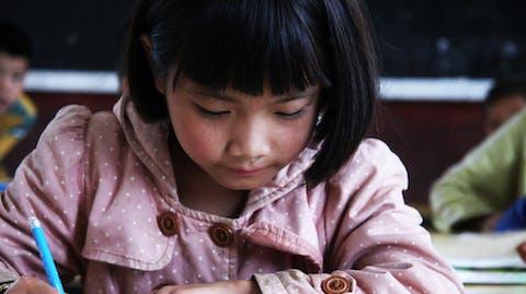 Meisje naar school China